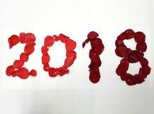 2018 avec des pétales de rose de rouge Photographie stock