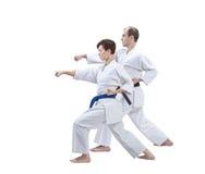 Avec la ceinture noire et la ceinture bleue les athlètes forment le bras de poinçon Photographie stock