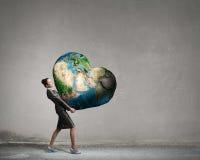 Avec le soin et amour à notre planète Image stock