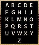 Or avec les lettres brillantes sur le fond foncé Photographie stock libre de droits