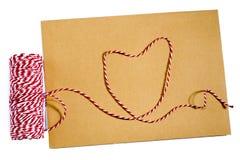 Avec un ruban, corde rouge, blanc, enveloppe, signification, amour Photographie stock libre de droits