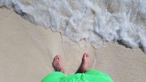 Avec vos pieds dans le sable Photographie stock libre de droits