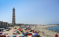 AVEIRO, PORTUGAL - JULY 31. Summer view of Barra beach with the Aveiro lighthouse in background, in Aveiro, Portugal, on July 31, 2011 Royalty Free Stock Image