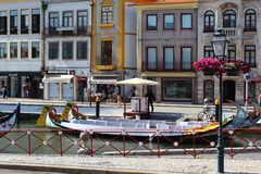 Aveiro, Portugal; June 15, 2018: Traditional boats on main city canal in Aveiro, Portugal. royalty free stock image