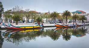 Tourists walk on famous Moliceiros of aveiro in Portugal stock photo