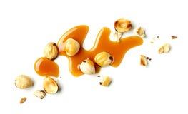 Avellanas y salsa del caramelo fotografía de archivo libre de regalías