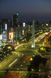Avenida 9 de Julio, widest avenue in the world, and El Obelisco, The Obelisk at night, Buenos Aires, Argentina stock photo