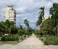 Avenida de los Presidentes, Havana. The tree lined avenue - Avenida de los Presidentes - stretching towards the Caribbean Sea through the Vedado district of Stock Image