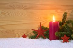 Christmas red decoration and Advent candle. Christmas card. Stock Photos