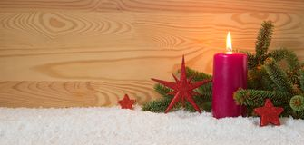 Christmas red decoration and Advent candle. Christmas card. Royalty Free Stock Photos