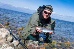 Aventura da pesca da truta de mar Foto de Stock Royalty Free