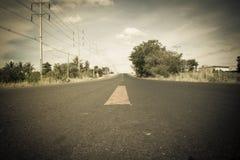 Aventura escrita na estrada rural Imagem de Stock