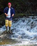 Aventure de la pêche de mouche Photo libre de droits