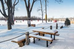 Aventure Mille Îles Ice fishing. Ice Fishing cabins with pinic table covered in snow, in a vast spaces on the frozen Rivière des Mille Îles in Ste-Rose Royalty Free Stock Images