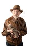 Aventureiro ou arqueólogo com ídolo Fotografia de Stock Royalty Free