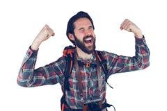 Aventurero emocionado con los brazos aumentados fotografía de archivo