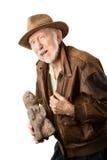 Aventurero o arqueólogo que ofrece vender el ídolo Imagen de archivo