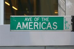 Avenue of the Americas. A sign for Avenue of the Americas, also known as Sixth Avenue, in New York City stock images