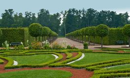 Avenue and bed in formal garden Stock Images