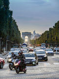 Avenue Champs Elysees. Late afternoon traffc at Avenue Champs Elysees with Arc de Triomph in the background royalty free stock images