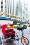 Avenue de 6ème poids du commerce New York pousse-pousse des Amériques Photos libres de droits