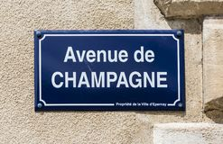Avenue de Champagne. Epernay, France - June 8, 2017: Road sign of the street `Avenue de Champagne` at a wall in Champagne district, France Stock Images