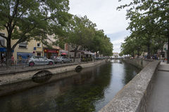 Avenue de la Libération, L'Isle-sur-la-Sorgue. Avenue de la Libération boulevard in L'Isle-sur-la-Sorgue, France. L'Isle-sur-la-Sorgue is a town and Royalty Free Stock Image
