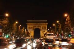 Avenue des Champs-Élysées in Paris at night. Famous Avenue des Champs-Élysées in Paris at night. In the background Arc de Triomphe Royalty Free Stock Photos