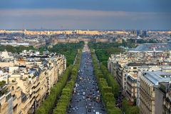 Avenue des Champs-Elysees afternoon. View of the Champs-Elysees with the Louvre in the background, seen from the Arc de Triomphe in the afternoon Stock Photography