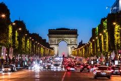 Avenue des Champs Elysees and Arc de Triomphe at night. Paris, F. Paris, France - June 25, 2017: The Avenue des Champs Elysees and Arc de Triomphe Arch of Royalty Free Stock Images