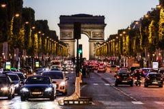 Avenue des Champs Elysees and Arc de Triomphe at night. Paris, F. Paris, France - June 25, 2017: The Avenue des Champs Elysees and Arc de Triomphe Arch of Stock Photography