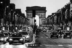 Avenue des Champs Elysees and Arc de Triomphe at night. Paris, F. Paris, France - June 25, 2017: The Avenue des Champs Elysees and Arc de Triomphe Arch of royalty free stock photography