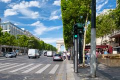 The Avenue des Champs Elysees on a beautiful summer day in Paris Royalty Free Stock Photography
