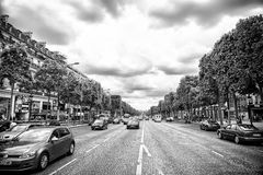 Avenue des Champs Elysees with busy traffic. Elysian fields road on cloudy sky. Vacation and travel in french capital. Paris, France - June 02, 2017: Avenue des royalty free stock image