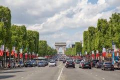 Avenue des Champs Elysees in Paris. Paris, France - May 13, 2017: View of the famous avenue des Champs Elysees and the Arc de Triomphe stock photos