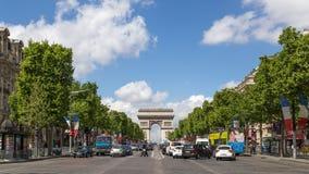 Avenue des Champs Elysees in Paris. Paris, France - May 13, 2017: View of the famous avenue des Champs Elysees and the Arc de Triomphe royalty free stock photography