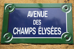 Avenue des Champs Elysees street sign in Paris, France. Stock Photos