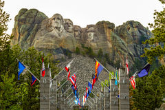 Mount Rushmore, Avenue of Flags. The flags of the 56 states and territories of the United States of America fly before the granite carving of Mount Rushmore Stock Photos