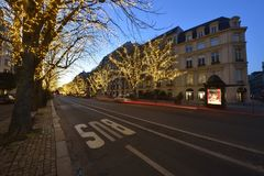 Avenue Montaigne in Paris. During the Christmas season, there are special lights on the Avenue Montaigne in the heart of Paris royalty free stock photo