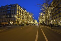 Avenue Montaigne in Paris. During the Christmas season, there are special lights on the Avenue Montaigne in the heart of Paris stock image