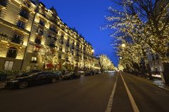 Avenue Montaigne in Paris. During the Christmas season, there are special lights on the Avenue Montaigne in the heart of Paris royalty free stock photos