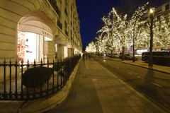 Avenue Montaigne in Paris. During the Christmas season, there are special lights on the Avenue Montaigne in the heart of Paris royalty free stock image