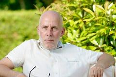 Average age man looks  camera Royalty Free Stock Photography