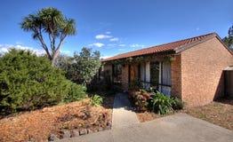 Average Brick Home. In suburbia Stock Photo