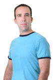 Average Guy. Half body shot of an average guy wearing a blue shirt, isolated against a white background Royalty Free Stock Photography