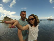 Average looking couple on the rocky beach Royalty Free Stock Photography