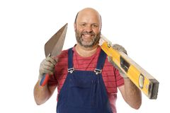 A Mature Brick Layer. An average manual worker posing with the tools of trade, a positive and cheerful attitude Stock Photo