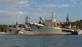 Average sea tanker Koida and Rescue vessel Epron in the Bay of Black Sea. Royalty Free Stock Images