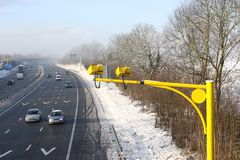 Average speed cameras in UK. Bright yellow cameras to record car average speeds Royalty Free Stock Images