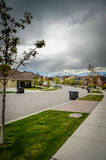 Average Suburb Street. Stormy Skies Over An Emptied Average Suburban Street royalty free stock images